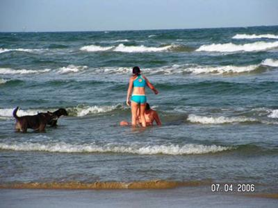 Playing in the surf at the Gulf.