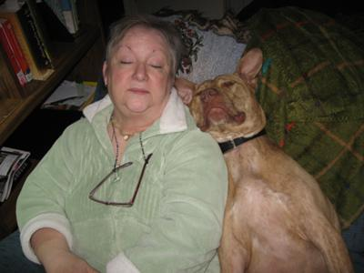 Peanut and Mommie sleeping in the recliner.